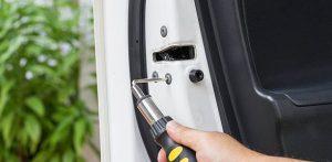 Automotive Locksmith Unscrewing a lock