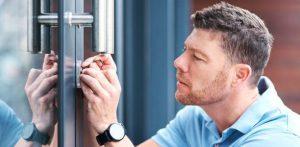 locksmith checking a lock